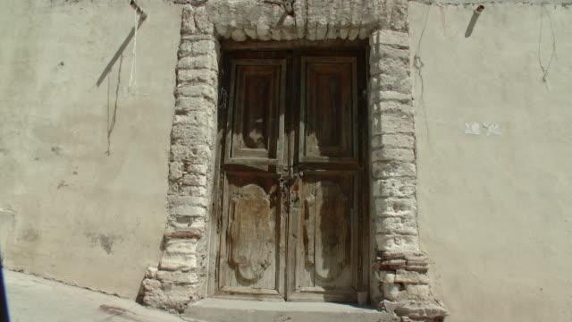 ms view of old doorway / real de catorce, san luis potosi, mexico  - doorway stock videos & royalty-free footage