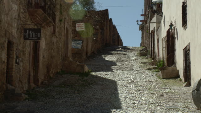 WS View of old empty cobblestone street / Real de Catorce, San Luis Potosi, Mexico