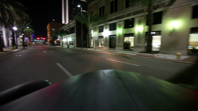ms ts view of old model cars driving down through street and turn left / jacksonville,florida,united states - jacksonville florida stock videos and b-roll footage