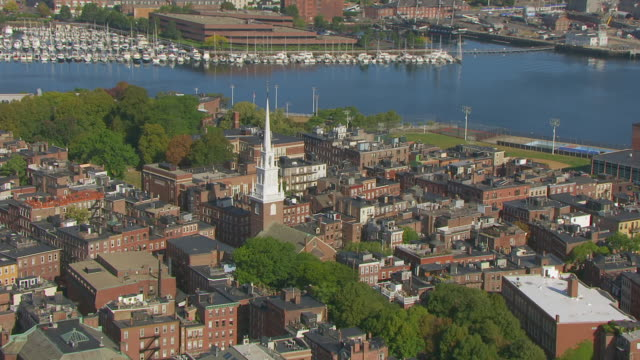WS AERIAL POV View of Old North Church, Boston Harbour in background / North End, Boston, Massachusetts, United States