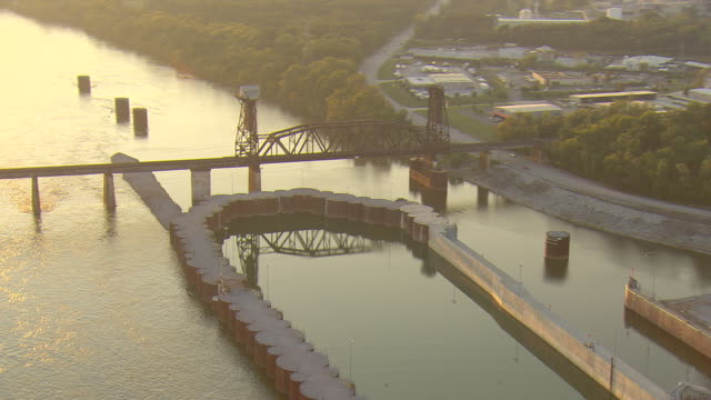 ws aerial view of old railroad drawbridge and powerlines crossing tennessee river / chattanooga, tennessee, united states - chattanooga stock videos and b-roll footage