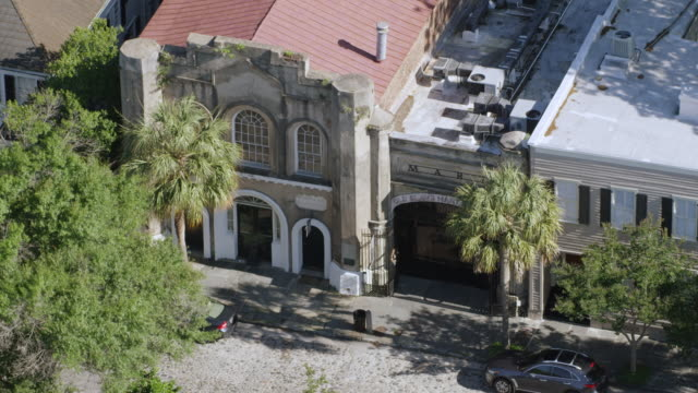 ws zo aerial pov view of old slave mart building at city / charleston, south carolina, united states - southern usa stock videos & royalty-free footage