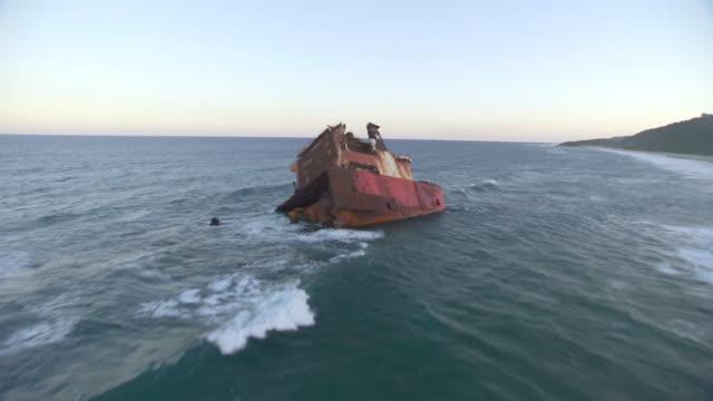 WS AERIAL View of old sunken ship in sea / Kwazulu Natal, South Africa