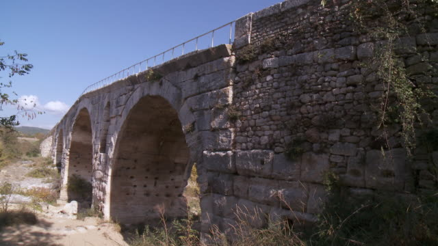 ms view of old three arched bridge / apt, provence, france - apt stock videos and b-roll footage