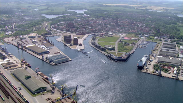 ws aerial view of old town wismar harbor and shipyard / wismar wal, germany - schiffswerft stock-videos und b-roll-filmmaterial