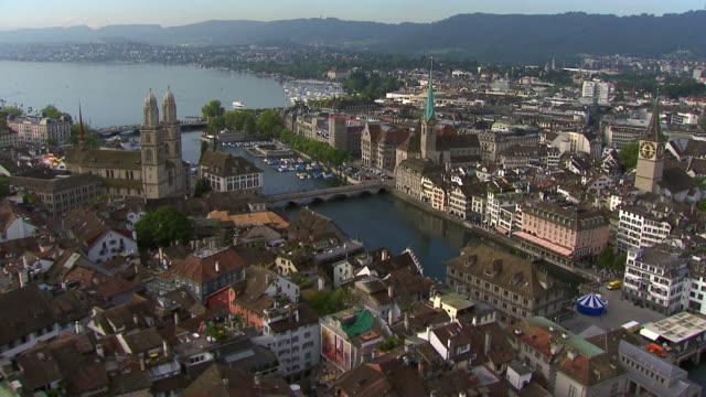 vidéos et rushes de ws aerial view of old town with limmat river and lake zurich / zurich city, zurich, switzerland - switzerland