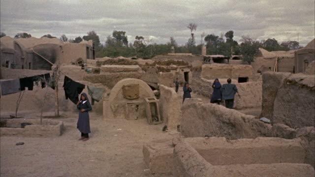 ms pan view of old village - adobe bildbanksvideor och videomaterial från bakom kulisserna