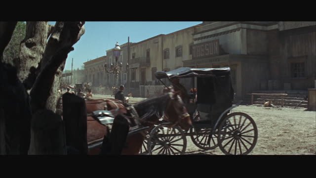 ws view of old western street with horses and people - arbeitstier stock-videos und b-roll-filmmaterial