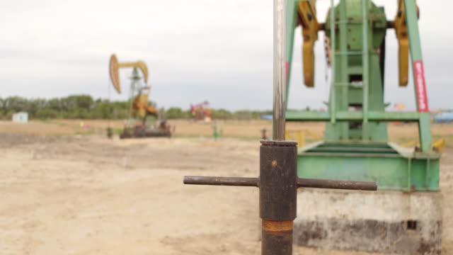 vídeos y material grabado en eventos de stock de a view of oli pumping units at daqing oil field on may 20 2017 in daqing china daqing is one of the most important oil city in china - estación de bombeo
