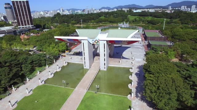 view of olympic park with world peace gate - seoul stock videos & royalty-free footage