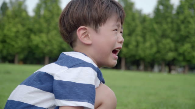 View of one boy crying and getting annoyed in summer at Seoulforest (the third largest park in Seoul city)