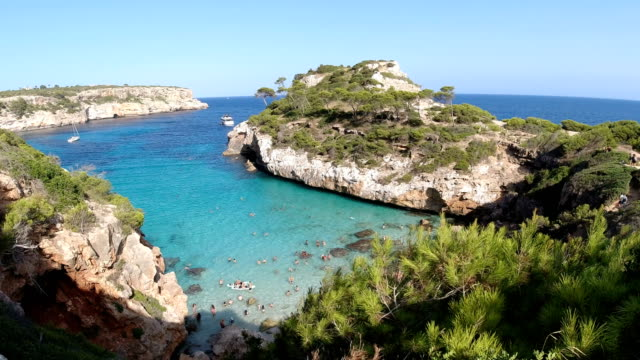 view of one of the most famous beaches in majorca - mediterranean sea stock videos & royalty-free footage