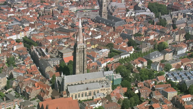 MS AERIAL PAN ZI View of Onze lieve Vrouekerk (tallest Belgian spire) and traffic moving by canal / Flanders, Belgium