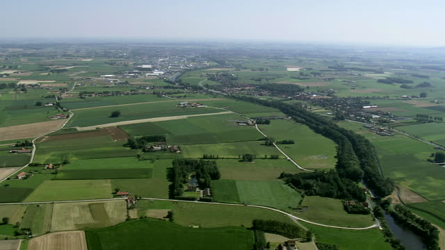WS AERIAL PAN View of open farm landscape / Flanders, Belgium