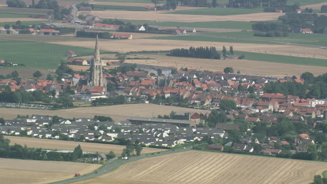 ws aerial pan zi view of open farm landscape with small houses in village / flanders, belgium - land stock videos & royalty-free footage