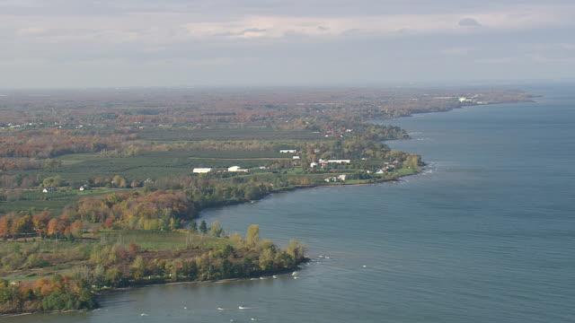 ws aerial view of open landscape and fields at shoreline of lake ontario / new york, united states - lake ontario bildbanksvideor och videomaterial från bakom kulisserna