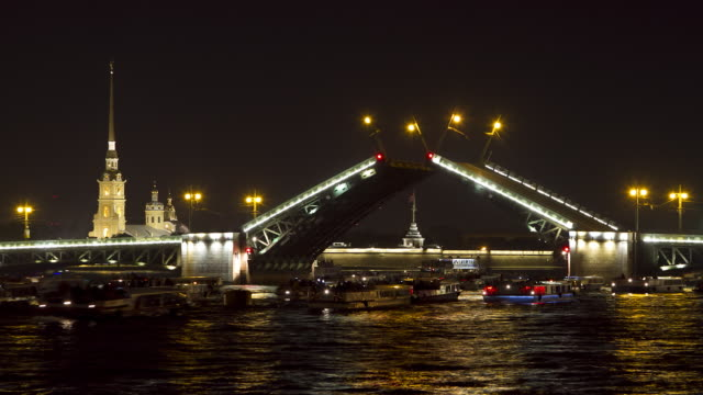 ws t/l view of opening palace bridge at night / sankt petersburg, russia - palace stock-videos und b-roll-filmmaterial