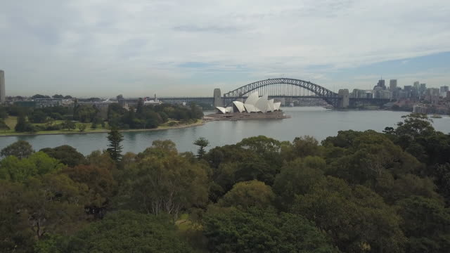 view of opera house and harbor bridge on the ocean at daytime in sydeny, australia - natural parkland stock videos & royalty-free footage