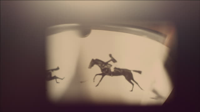 view of operating film projector inside part with moving image(horse race) - 電影放映機 個影片檔及 b 捲影像