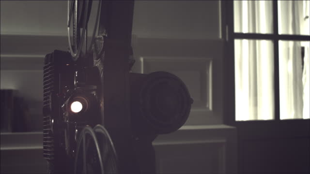 View of Operating Film projector with flashing lights