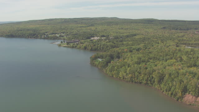 ws aerial view of orbit around outline of fedora shipwreck in buffalo bay / wisconsin, united states  - lago superiore video stock e b–roll