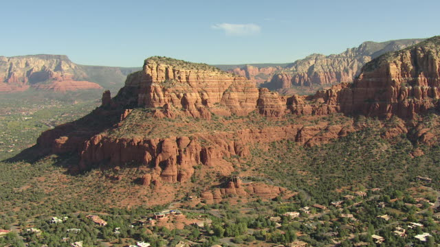 ws aerial view of orbit chapel of the holy cross with rock formations / sedona, arizona, united states  - sedona stock videos & royalty-free footage