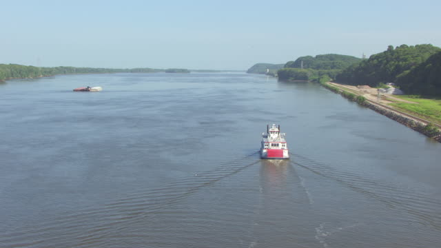 ws aerial ds zi view of orbit mark twain riverboat on mississippi river / hannibal, missouri, united states - mark twain stock videos & royalty-free footage