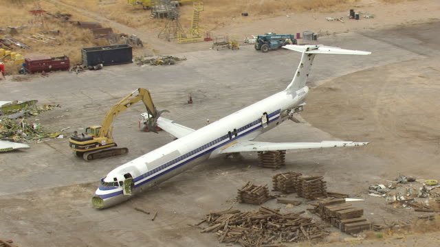 WS AERIAL ZI View of orbit MD80 commercial jet airliner on scrap pad and workers removing supports / Roswell, New Mexico, United States