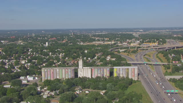 ws aerial ts view of orbit painted grain elevators and downtown / omaha, nebraska, united states - omaha stock videos & royalty-free footage