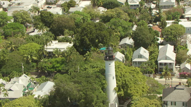 ms aerial zo view of orbit showing shutters and porch around hemingway house / key west, florida, united states - key west stock videos & royalty-free footage