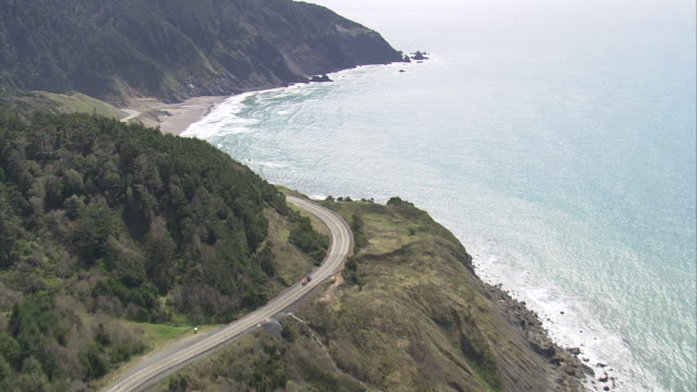 ws aerial view of oregon coast highway with mountain / united states - oregon coast stock videos & royalty-free footage