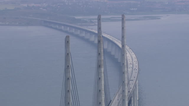 ws aerial view of oresund bridge / copenhagen, denmark - regione dell'oresund video stock e b–roll