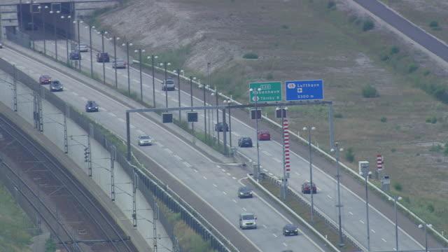vídeos y material grabado en eventos de stock de ws aerial zo view of oresund bridge tunnel / copenhagen, denmark - puente de oresund