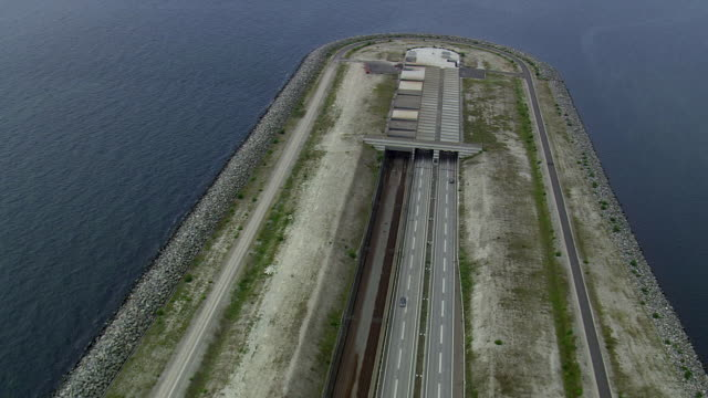 WS AERIAL ZO View of oresund bridge tunnel entrance ship in sea / Copenhagen, Denmark