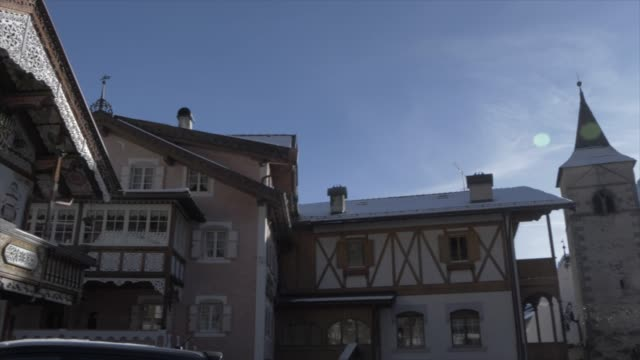view of ornately painted house in canazei town on sunny day in winter, province of trento, trentino-alto adige/sudtirol, italy, europe - canazei video stock e b–roll