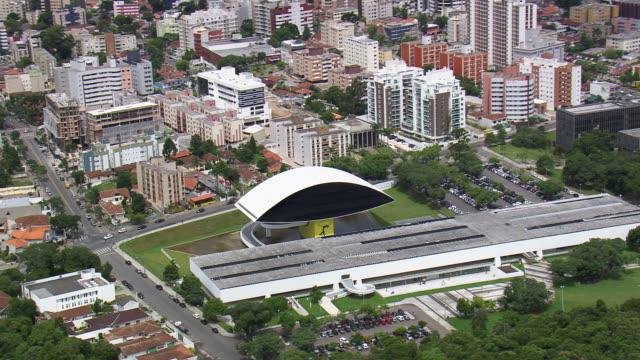 ws aerial view of oscar niemeyer museum surrounding area / parana, brazil - oscar niemeyer stock videos and b-roll footage