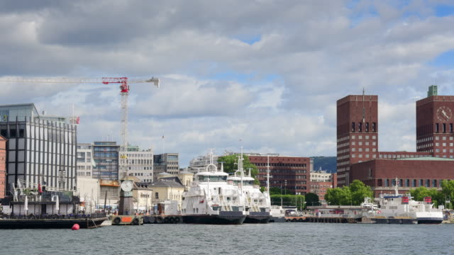 view of oslo city hall with harbour / oslo, norway - ferry stock videos & royalty-free footage