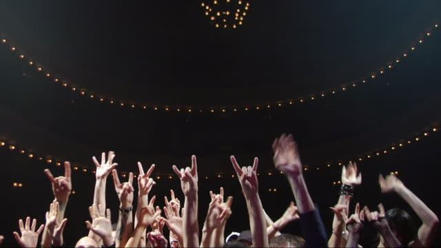 ws view of outstretched arms of fans at a rock & roll concert / buenos aires,  argentina - punching the air stock videos & royalty-free footage