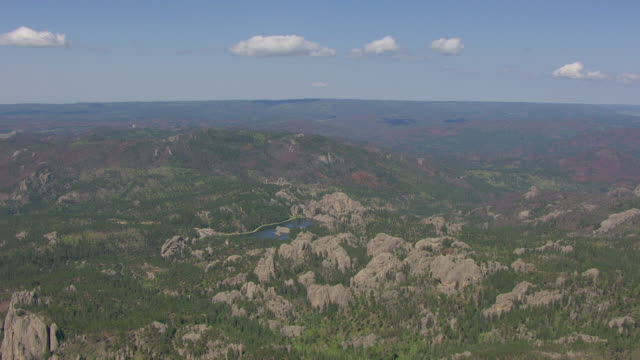 ws aerial view of over cathedral spires in custer state park in custer county / south dakota, united states - custer staatspark stock-videos und b-roll-filmmaterial