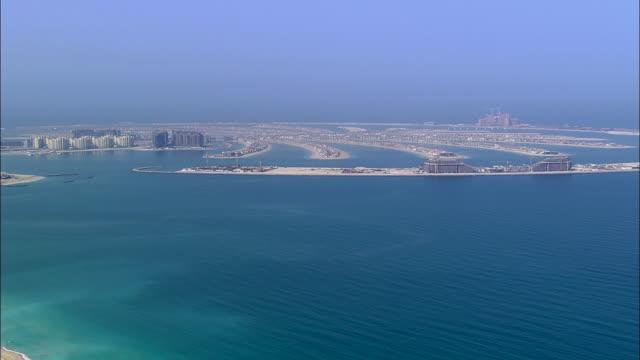 AERIAL ZI view of over Dubai and sea / Dubai, United Arab Emirates
