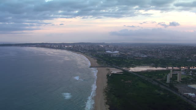 ws aerial view of over durban during sunset/sunrise / durban, kwazulu-natal, south africa - durban stock videos and b-roll footage