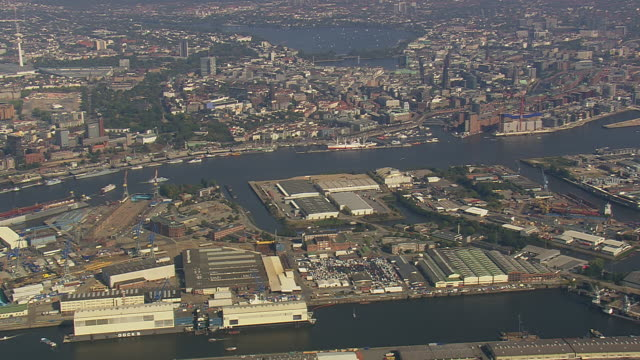 ws aerial view of over hamburg port / germany - porto marittimo video stock e b–roll