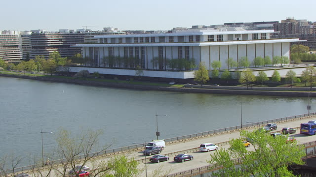 ms zo aerial pov view of over potomac river and traffic moving on bridge / arlington memorial bridge, john f. kennedy memorial center for the performing arts, washington dc, united states  - john f. kennedy center for the performing arts stock videos and b-roll footage