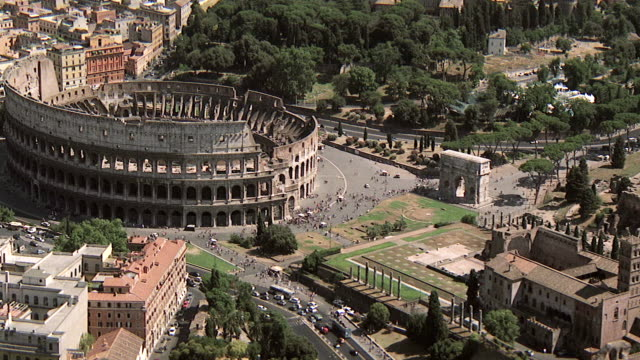 WS AERIAL View of over Roman Forum, Constantine Basilica and Coliseum / Rome, Italy