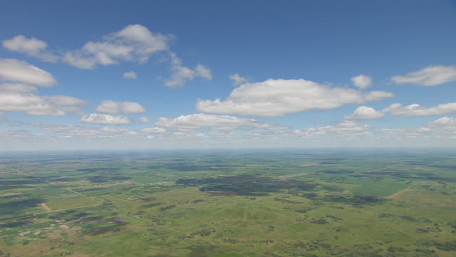 ws aerial pan view of over sheyenne national grassland with cloud shadows / north dakota, united states - national grassland stock videos & royalty-free footage