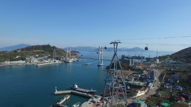 stockvideo's en b-roll-footage met view of overhead cable car and dolsan bridge in yeosu, jeollanam-do - voor anker gaan