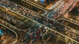 T/L PAN View of Overpass and City Traffic at Night / Beijing, China