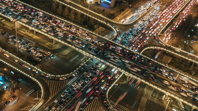 t/l pan view of overpass and city traffic at night / beijing, china - timelapse stock videos & royalty-free footage