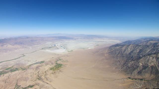WS AERIAL POV View of Owens Valley towards dry Owens Lake bed with foothills of the Sierra Nevada, Inyo Mountains in background / California, United States
