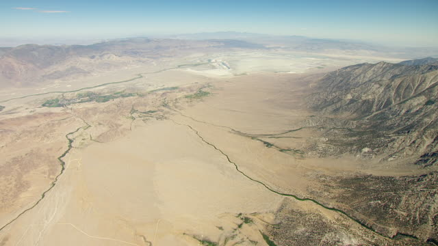 ws aerial pov view of owens valley towards dry owens lake bed with foothills of the sierra nevada, inyo mountains in background / california, united states - lake bed stock videos & royalty-free footage